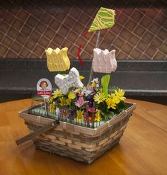 A festive Spring arrangement featuring Little Debbie Tulip Cakes, Butterfly Cakes and Kite Brownies is sure to put smiles on your guests faces!