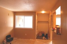 Let There Be Light! A Living Room Renovation Project with a New Ceiling, Pot Lights, and Hanging Lights – Part 1