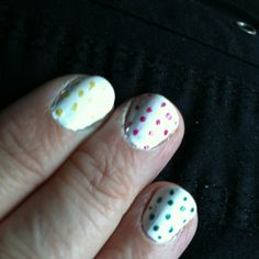 White nail polish with polka-dots from colors I had. Have gotten lots of compliments.