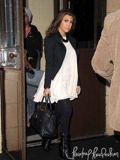 Kourtney Kardashian-Cameo dress, Kardashian Kollection jacket, H necklace, Wolford tights, Giuseppe Zanotti boots and Hermes bag.