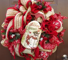 This Christmas wreath speaks warm and cozy!    I made this wreath in beautiful deep red and natural burlap fabrics. I added a large bow in a