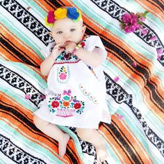 Adorable hand embroidered Mexican dress with colorful floral pattern on a lightweight cotton dress. Great for summer, fiesta, or beach. These dresses run small, each is hand made so variations in sizi