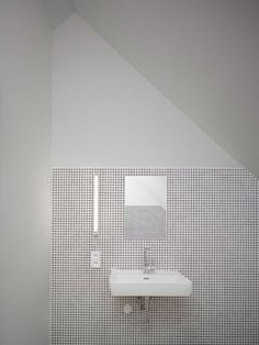 tiny tiles + placing the fluorescent light vertically in alignment with the outlet