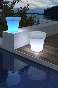 Light-up planters. Pretty cool! Definitely makes for a different kind of outdoor look. -D