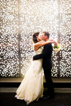Use lights to create a whimsical wedding background.RELATED: How To Plan An At-Home Wedding