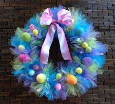 I like the tulle in variegated colors but would add some delicate butterflies and bling instead for other events.