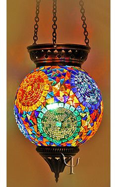 Beautiful!! This is a great inspiration piece to make one myself...do glass mosaic over either a clear or opaque light globe creating your own design and one of a kind light.   Mosaic Hanging Lamp @ http://www.yurdan.com/yrdn/ProductDetails.aspx?catalogID=YRDN_HomeDecor==HM_015_1