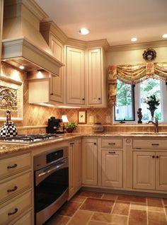 COLORS are excellent!! Just love this kitchen!! Especially the stone insert above range.
