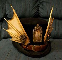 "Love the custom wings on this top hat! ""The DiVinci with plate."""