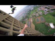 The BASE Race  The BASE Race is Max and Jean racing to the top of an abandoned building in South Africa. All to end up doing a base jump to finish the race. This was shot with the Hero3 camera. What this camera has contributed to the sport videos is really amazing.  http://TheDailyLaugh.net The Digital Newspaper for all your laughing needs.