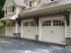 Did you remember to shut the garage door? Most smart garage door openers tell you if it's open or shut no matter where you are. A new garage door can boost your curb appeal and the value of your home. House, Carriage House, House Exterior, House Doors, Garage Doors, Garage Pergola, Garage House, Garage Door House, Garage