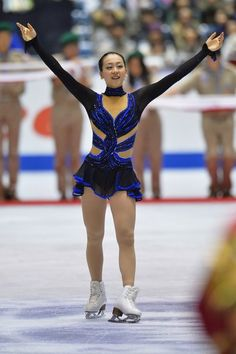 TOKYO, JAPAN - NOVEMBER 09:  Gold medalist Mao Asada of Japan waves to fans during day two of ISU Grand Prix of Figure Skating 2013/2014 NHK...
