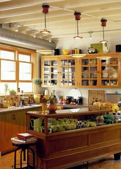 RePurposing a Retail Counter as an Island: image via Better Home & Gardens   kitchen trends 2013 part 3 industrial look