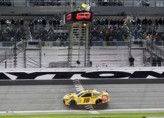 © AP Photo/Terry Renna Kyle Busch crosses the finish line to win the second of two qualifying races for Sunday's NASCAR Daytona 500 Sprint Cup series auto race at Daytona International Speedway in Daytona Beach, Fla., Thursday, Feb. 18, 2016.