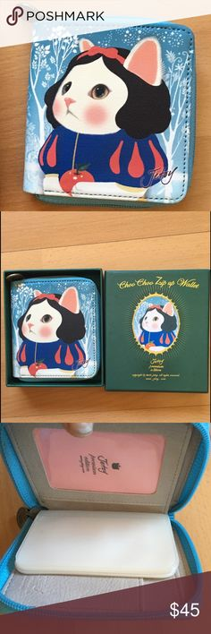 Snow White Jetoy wallet Super cute rare unique Jetoy cat wallet ! In original box NWOT. The box is a little marked but the wallet is perfect ! 4x4 Jetoy Bags Wallets