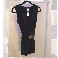 Black romper! New with tags black belted low V romper! Belt may have some scratches from handling Shorts