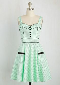 Spark a retro revival in this mint green dress! You believe that iconic style shouldn't be left in the past, so when you flaunt the collared, sweetheart neckline, black piping, pockets, and adorable decorative buttons of this black-dotted A-line, all of your vintage-inspired visions permeate the present tense!