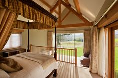 Luxurious four poster bed at Chescombe Lodge. Perfect for a romantic break for two. Popular for honeymoons and special occasion breaks.