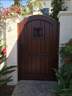 Custom Wood Gate with Pineapple Grill by Garden Passages