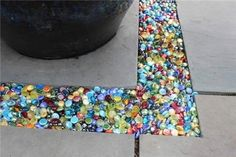 Colored glass Instead of gravel in the garden or patio...you can get these at the dollar store.                                                                                                                            More
