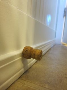 Champagne Cork as Door stop instead of those annoying spring thingies that always break.