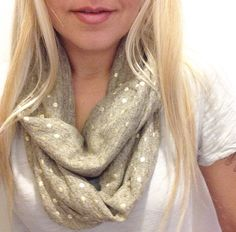 Soft and stretchy infinity scarf. Sand color with subtle gold polkadots. Super cute and festive!