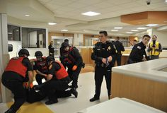 Burlington Police and Fire Departments conducting an active shooter drill at @laheyhealth new ER. Police stand guard over the fire departments Rescue Task Force.