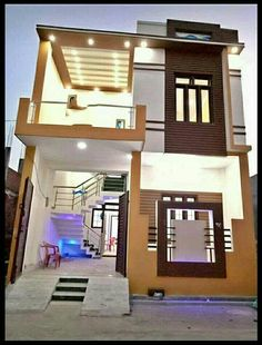 front elevation designs for duplex houses in india House Main Door Design, 3 Storey House Design, Bungalow House Design, Small House Design, Cool House Designs, 20x30 House Plans, 2bhk House Plan, Indian House Plans, Modern House Facades