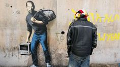 Banksy new artwork at the Jungle  refugee camp (Calais, Paris) showing Steve Jobs whose birth father was a Syrian immigrant.