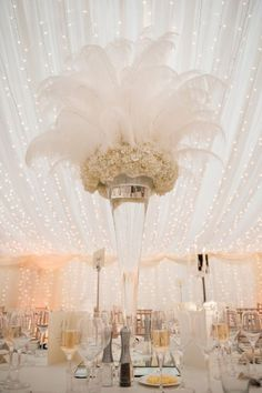 Wedding Themes At the back of the sanctuary, behind the first chairs of the aisle. OR Centerpiece for bride and groom table and cake table - Take a look at 15 glamorous Great Gatsby wedding decorations in the photos below and get ideas for your wedding! Gatsby Wedding Decorations, Quinceanera Decorations, Great Gatsby Wedding, 1920s Wedding, Glamorous Wedding, Mod Wedding, Wedding Themes, Wedding Table, Dream Wedding