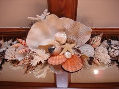 Seashell frieze atop a beamed ceiling! Gorgeous idea.