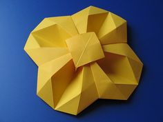Fiore geometrico - Geometric Flower. Origami: from one uncut square of copy paper, 21 x 21 cm. Designed and folded by Francesco Guarnieri, April 2011. Crease Pattern: http://flic.kr/p/9AWzCi