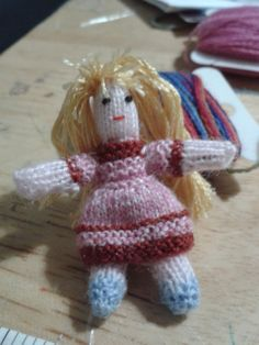 little miniature knitted dolly measures approx 2 inches tall