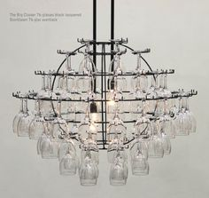 I want one! Wine glass storage chandelier... several other interesting ones on the sitte too.