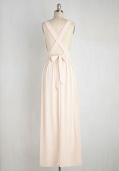 The go-to gal of the gala, you maintain a magnificent look in this petal pink maxi dress while overseeing a smooth operation. Ever-so-elegantly finessed with a plunging neckline, pintucked bust, pleated waist, and tied open back, this beautiful chiffon gown brings an elegance to the event that will be remembered for years to come!