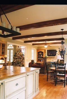 Wood beams and white ceiling.