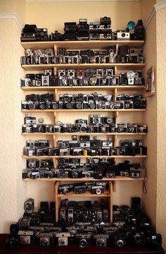 I'd like to have this wall covered in cameras, please...you can throw in a few DSLR's too! ;)