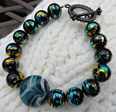 25% of proceeds benefit a non-profit animal rescue group. Black and Blue Metallic Gold Swirls Glass Beaded by StephieGknits, $20.00