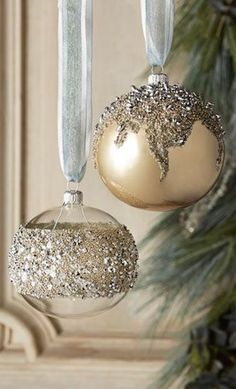 This would make a simple DIY. Glue, german glass glitter, and old mercury glass Christmas ornaments!