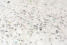 Recycled glass countertops are made from curbside recycled glass by company named Vetrazzo. Color: Glass House.