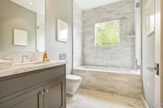 Contemporary Full Bathroom with complex marble tile floors, Floating toilet, Undermount sink, frameless showerdoor, Flush