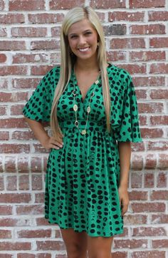 The Wildflower Dress is a wonderful wrap style dress made by Hourglass Lilly. Oversized sleeves and a stylish V-neck make for a flattering bodice.  The empire waist is defined by a band of fabric just under the bust.  The pattern is an adorable green and black polka dotted design that is totally modern meets vintage.  *Make sure to look at this necklace in our jewelry section!
