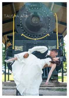 Bride & Groom kissing in front of a train. Romantic - beautiful - dream wedding   Nashville TN - Parthenon -  Photo by Tausha Ann Photography