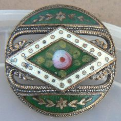 An antique enamel button, love!