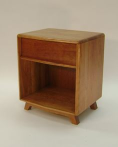 This cherry nightstand was made as a companion piece to a contemporary chest of drawers.