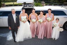 Emma's stunning bridal party looking like goddesses in their Goddess By Nature Signature ballgowns in Dust Me Pink colour.