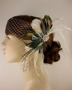 Feather Bridal Fascinator colors of feathers would a little deeper, like, purples, greens, blues, and maybe yellow?!