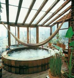 Wonderful hot tub made to appear like a huge wooden barrel! Love the hammock above it! You can roll right into blissfulness!
