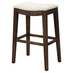 Perfect pulled up to your kitchen island or pub table, this classic barstool showcases a saddle seat and nailhead trim.  Product: