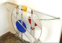 Frank Lloyd Wright inspired table design.  Stained glass breaks through table.